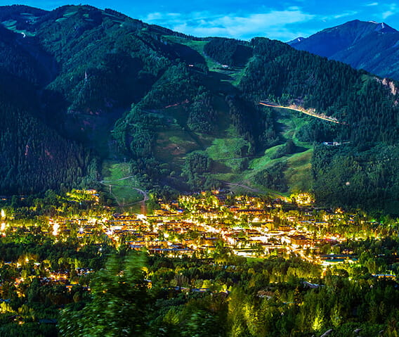 View of Aspen Mountian behind the town of Aspen lit up at night