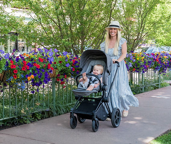 mother pushing stroller in aspen