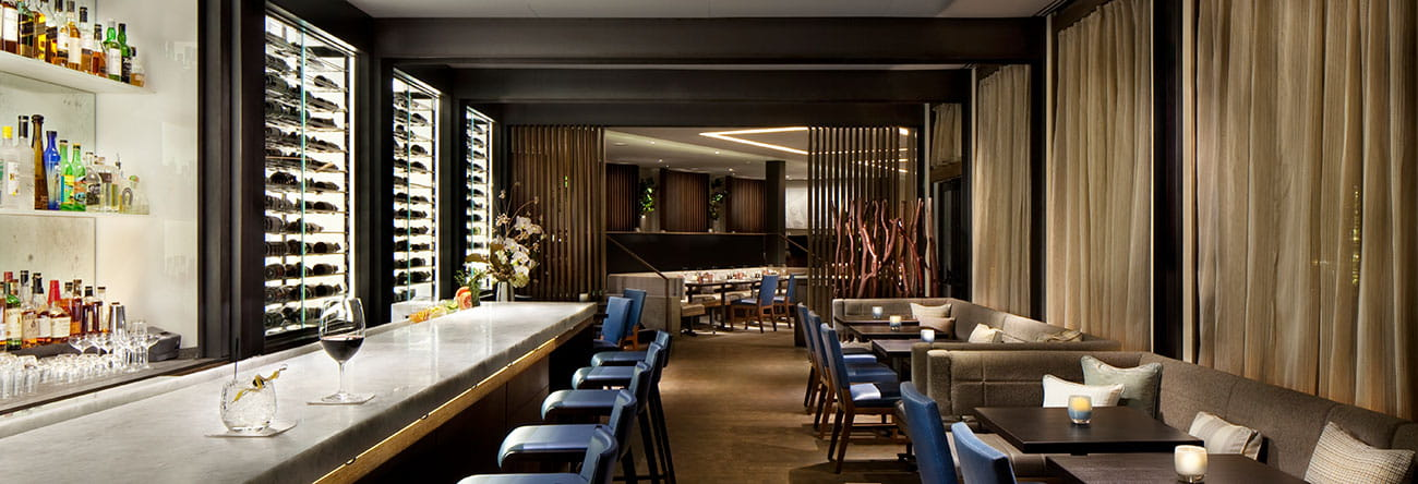The bar at Element 47 features a diverse bar menu and award-winning wine list in a sleek atmosphere.