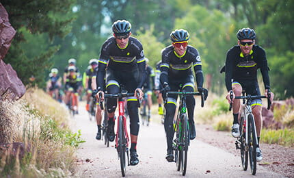 Former professional cyclists George Hincapie, Christian Vande Velde and Craig Lewis lead the pack on a bike ride in Aspen during The Little Nell's annual Clip-In With Christian Cycling Camp.