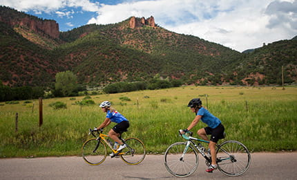 Cyclists bike down the Rio Grande Trail in the Roaring Fork Valley.