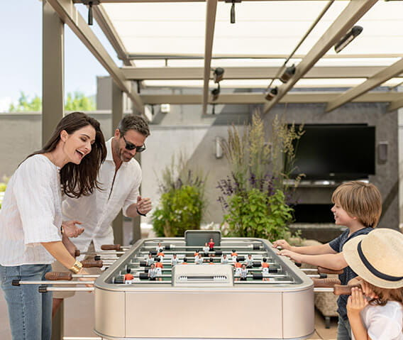 The rooftop garden deck at the Residences at The Little Nell offers activities for the whole family to enjoy, such as a foosball table.